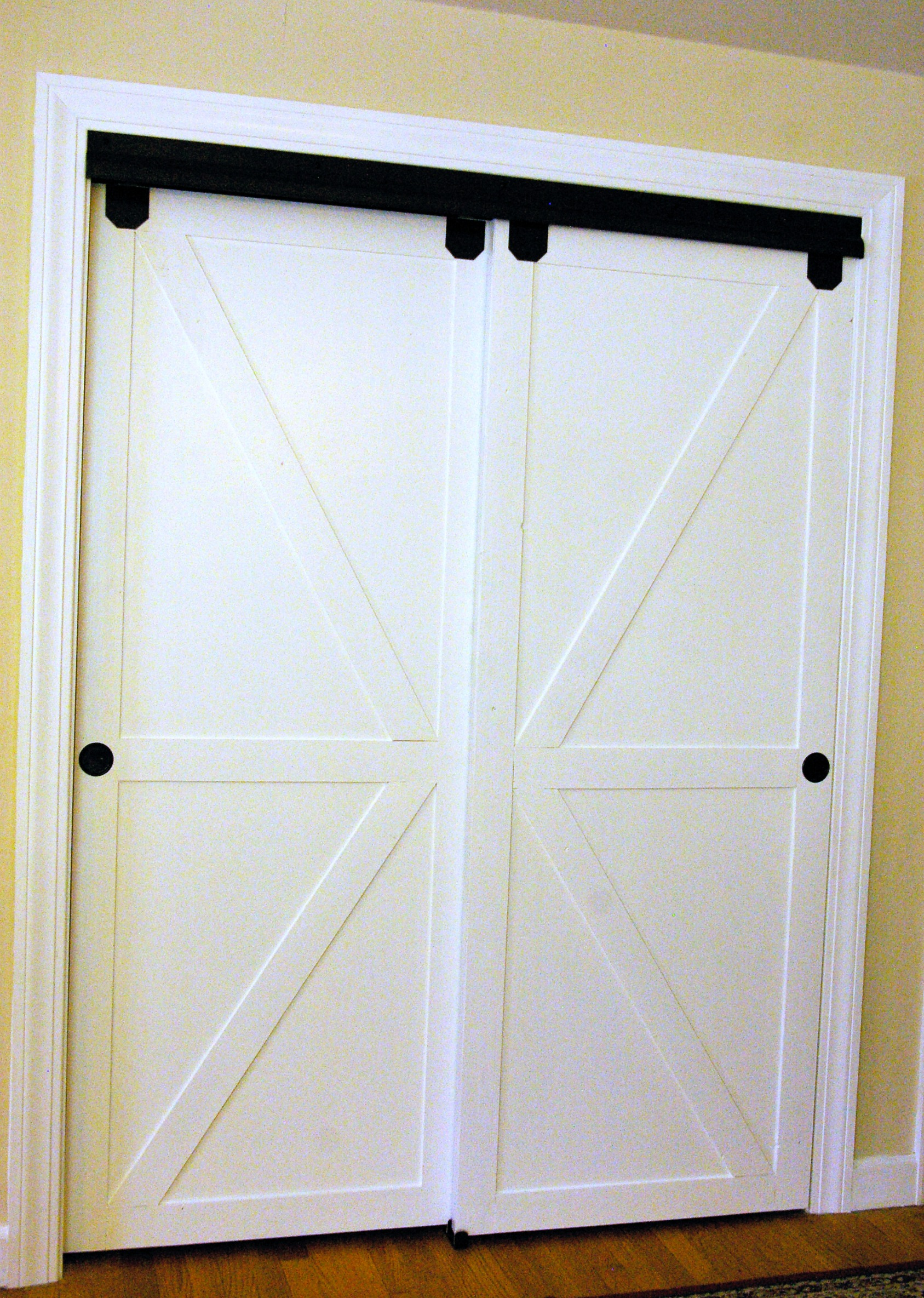 Diy Faux Barn Doors On A Sliding Bypass Closet Door 02 Featured On @Remodelaholic Edit & Remodelaholic | How to Make Bypass Closet Doors Into Sliding Faux ... pezcame.com
