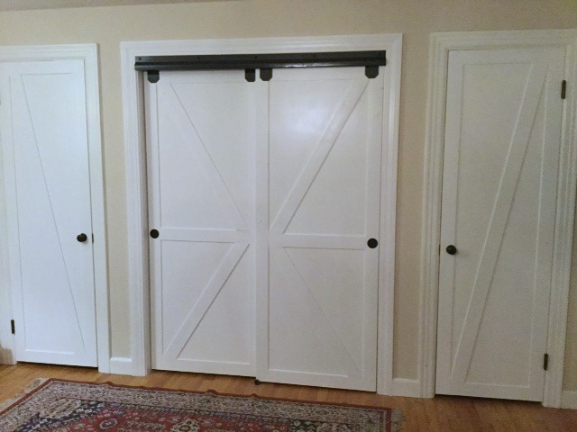 remodelaholic how to make bypass closet doors into sliding faux barn doors. Black Bedroom Furniture Sets. Home Design Ideas