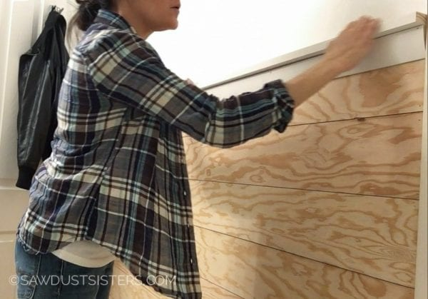 7 Tutorial For Installing A Shiplap Wall, Plywood DIY, By Sawdust Sisters Featured On @Remodelaholic