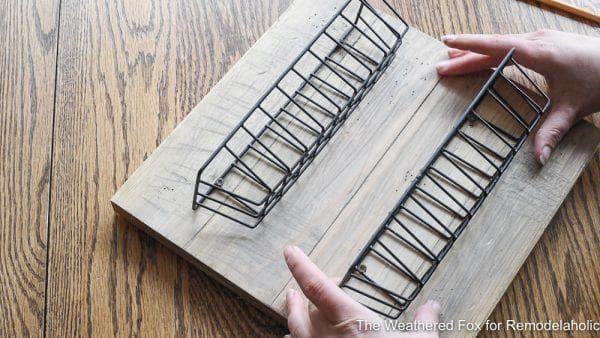 Simple Tutorial On How To Create Farmhouse Style Wall Baskets With Dollar Store Items. Get This Tutorial From The Weathered Fox On Remodelaholic!