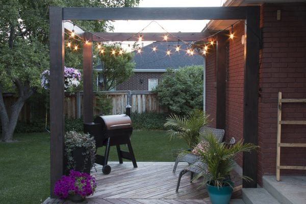 Modern Deck Pergola by remodelaholic.com with string lights for added light