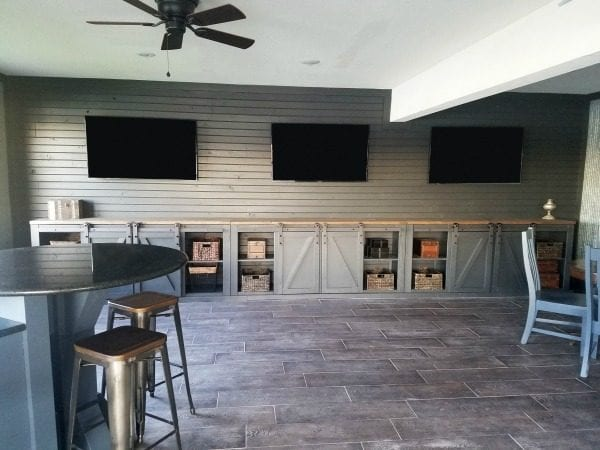 Sliding Barn Door Entertainment Center man cave idea from Diva of DIY on Remodelaholic