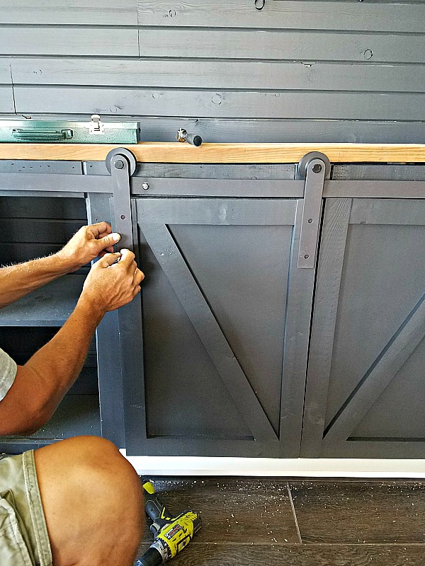 How To Build A Sliding Barn Door entertainment console For Your Man Cave by DIva of DIY on Remodelaholic
