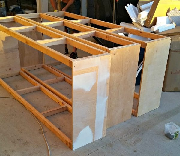 Build A Sliding Barn Door Entertainment Center For Your Man Cave from Diva of DIY on Remodelaholic