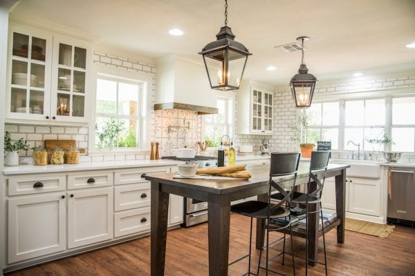 Get This Look: Fixer Upper Worm House Kitchen Image via Magnolia used with permission, warm white kitchen with wood tones