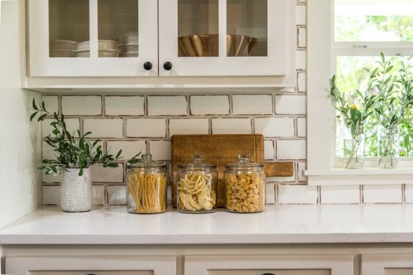 Get This Look: Fixer Upper Worm House Kitchen Image via Magnolia used with permission, beautiful and functional glass canisters