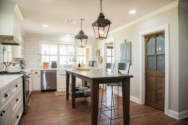 Get This Look: Fixer Upper Worm House Kitchen Image via Magnolia used with permission, warm white kitchen with wood tones and more