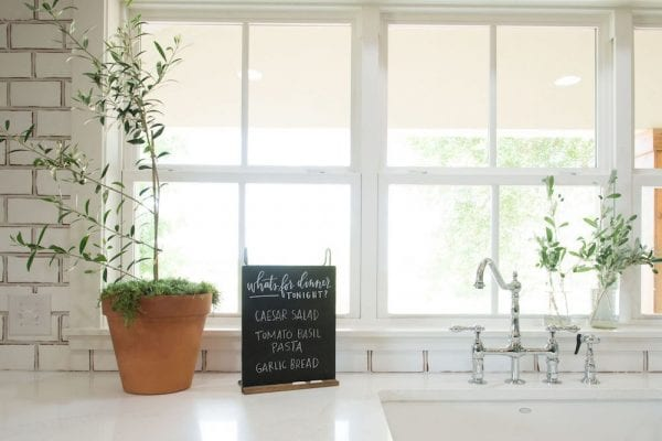 Get This Look: Fixer Upper Worm House Kitchen Image via Magnolia used with permission, chalkboards and greenery in the kitchen
