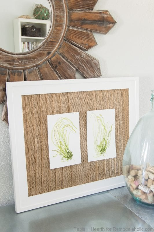 Create an easy rustic or coastal art display with this layered burlap frame mat. Add family photos or art prints, and easily swap them for holiday and seasonal decorating.