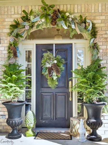 Christmas Garland And Wreath With Supar Pine Cones And Magnolia. Front Porch.