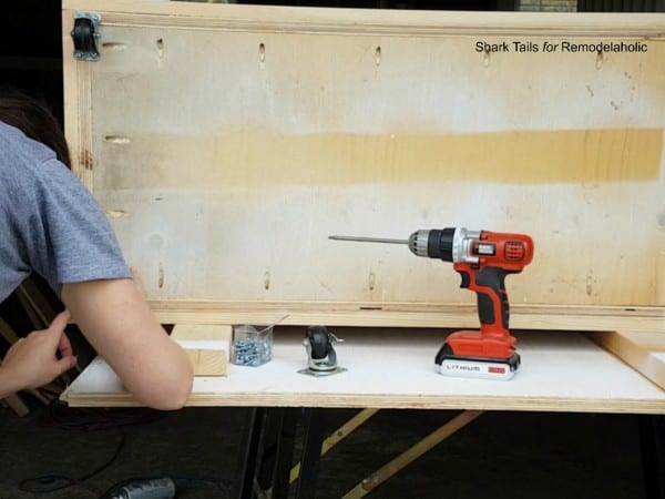 how to build a one sheet plywood storage box, add casters