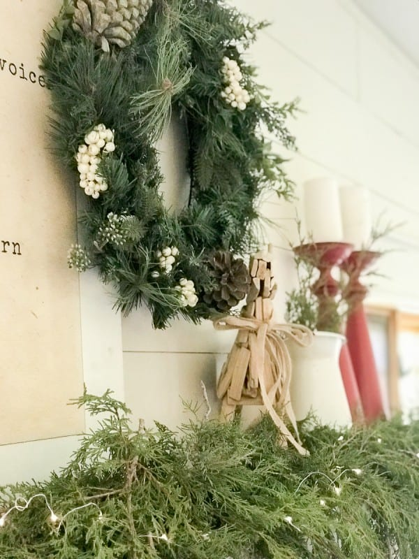 Create the perfectly styled farmhouse Christmas mantel this year with these helpful tips and tricks to creating a beautiful space.