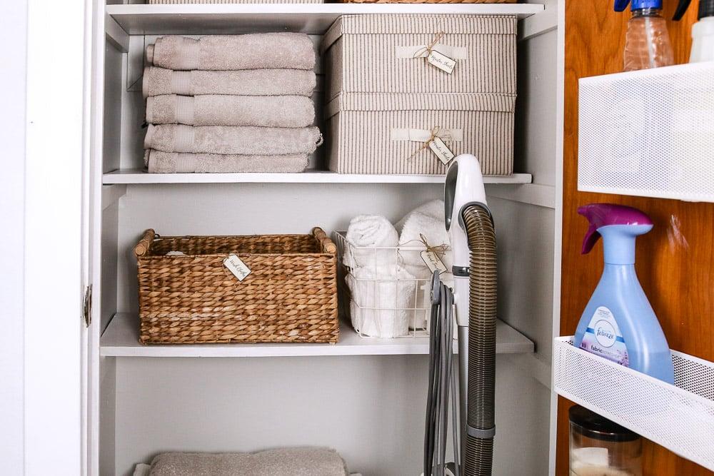 remodelaholic organized linen closet makeover rh remodelaholic com Linen Closet Organization Hallway Closet Makeover
