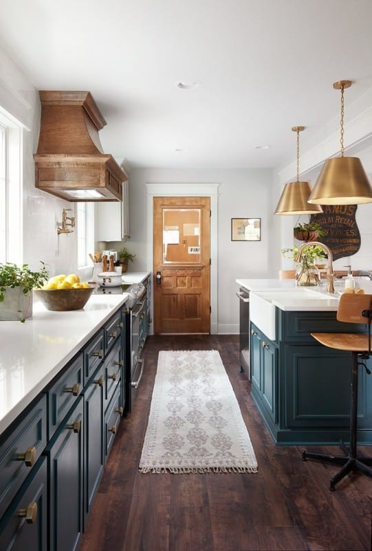 Fixer Upper Plain Jane House Kitchen. Love the white cabinets with the peacock blue island and gold pendants. Get This Look: Fixer Upper Plain Jane House Kitchen images via Magnolia Market used with permission. Featured on Remodelaholic.com