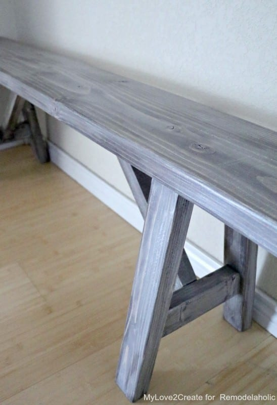This rustic farmhouse style easy DIY bench is the perfect seating solution for an entryway, bedroom, or dining bench. It requires just 3 boards and will only cost about $25 to build.