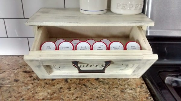 This DIY countertop spice storage bin features a tilt-out drawer and faux shiplap sides for stylish kitchen organizing! Plus, get the free printable spice drawer label and round spice bottle labels in two styles. Free building plan and printable space labels at #remodelaholic
