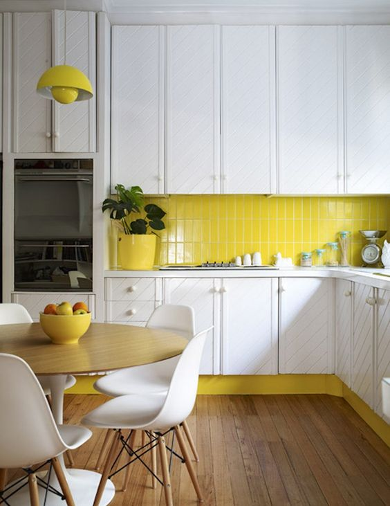 Sunny yellow kitchen backsplash and kickplate with white cabinets | Yellow Kitchen Inspiration #Remodelaholic
