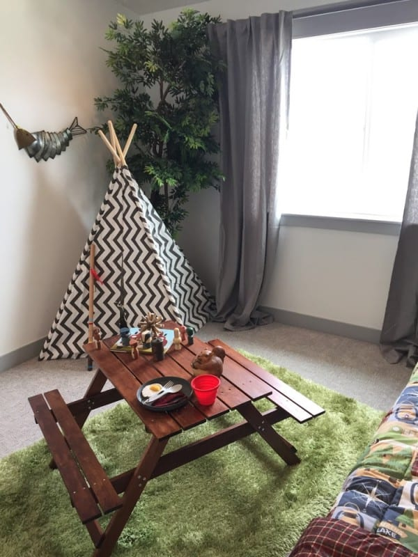 Let's go camping! Decorate a fun outdoorsy camping theme bedroom for your son or daughter with these easy tips and DIYs! #remodelaholic #getthislook