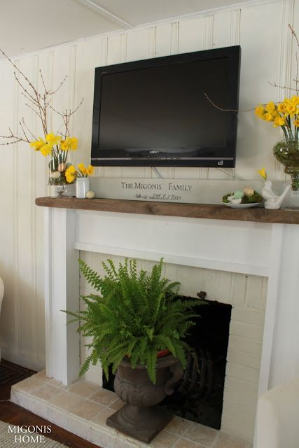 Ideas for Decorating Around a TV Over the Fireplace Mantel, simple white mantel decor via Migonis Home