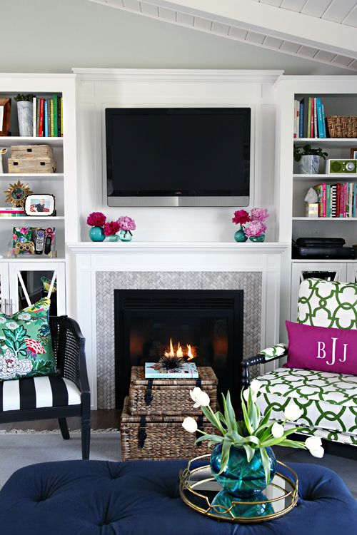 Ideas for Decorating Around a TV Over the Fireplace Mantel, white fireplace mantel with builtins via I Heart Organizing