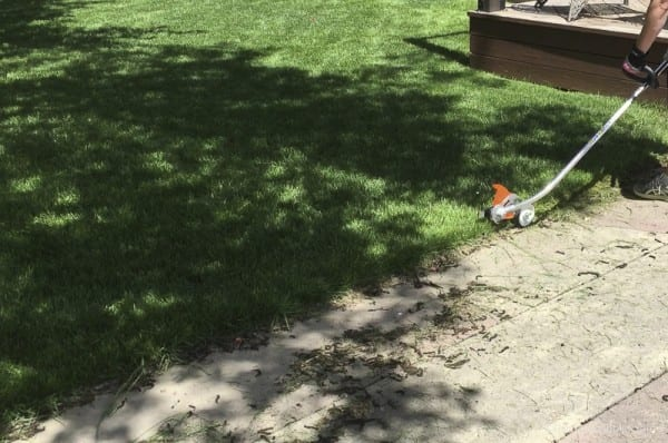 Lawn maintenance tips For Edging Your Lawn Like A Pro With Stihl @Remodelaholic 30
