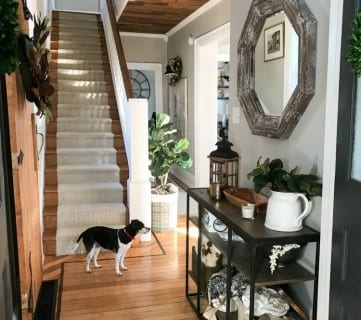 Hallway With Cream Runner And Wood And Metal Console Table