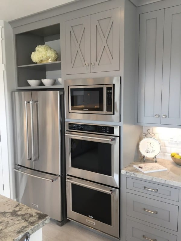 Stunning gray kitchen cabinets with french door refrigerator, farmhouse style accent cabinets, a built-in microwave, and a double in-wall oven #remodelaholic #getthislook