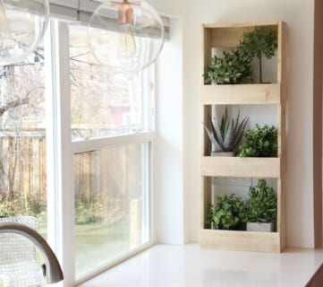 Easy To Build Rustic Wood Wall Bin With Plants #remodelaholic
