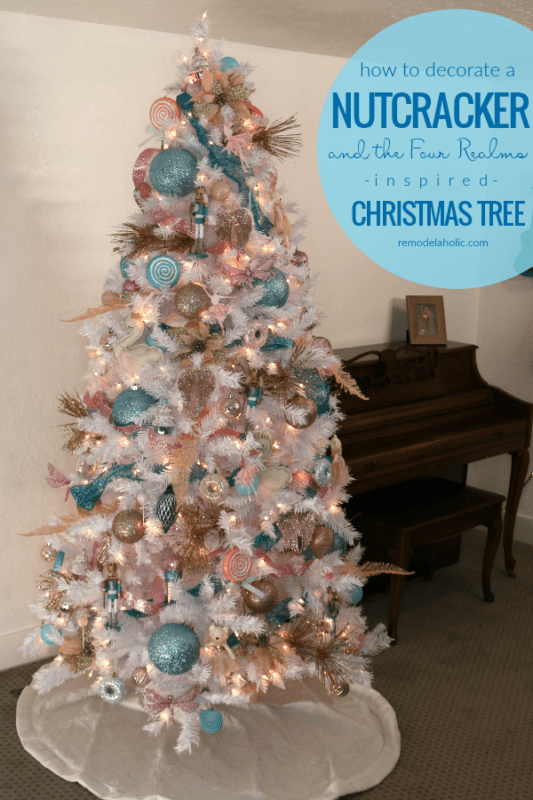 We found an affordable white Christmas tree and gave it a Nutcracker-inspired decorating theme featuring ballerinas, candy lollipops, miniature nutcrackers, and more in pastel blue, blush pink, and rose gold. See more of this Nutcracker and the Four Realms Christmas tree at Remodelaholic.com #remodelaholic #christmastree #christmasdecorating #nontraditionalChristmascolors #vintageChristmas