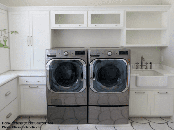 Stainless Steel Front Loading Washer And Dryer In White Laundry Room, Jerry Stubbs Construction And Tique And Company, 2018 Utah Valley Parade Of Homes Featured On Remodelaholic