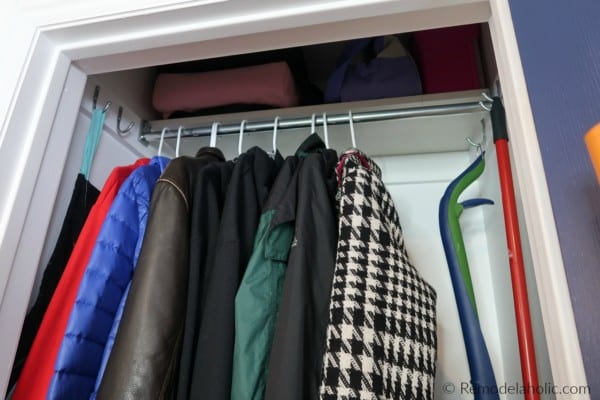 Add Storage To A Coat Closet By Raising The Hanging Rod And Adding A Higher Top Shelf For Storage #remodelaholic