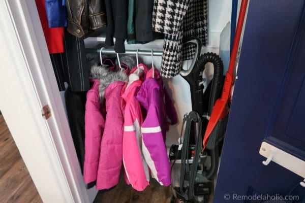 Kid Friendly Coat Closet Organization And Broom Closet With Lower Shelf And Hanging Rod And Room For Cleaning Supplies And Vacuum #remodelaholic