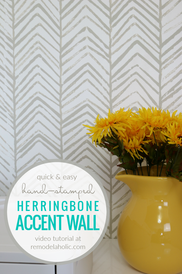Quick Cheap And Easy Hand Stamped Accent Wall In A Geometric Herringbone Pattern |Get a designer look for less by DIYing a hand-stamped accent wall in a herringbone pattern using just a scrap of cardboard and a small paint sample can! Create any geometric design you like with this easy tutorial for a stamped wallpaper look. #remodelaholic
