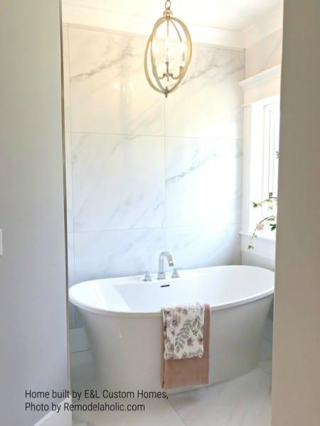 Bathtub In Private Nook With Window E&L Custom Homes (72).ed