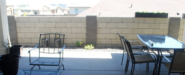 Cinder Block Fence Before Upgrade To Wood Slat Planter Wall, The Garden Glove Featured On Remodelaholic