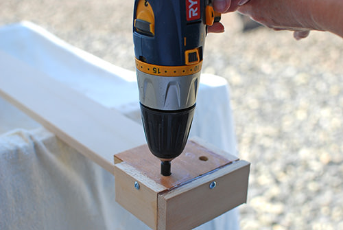 DIY Jig To Attach Wood Boards To A Concrete Block Fence For A Garden Planter Wall, The Garden Glove Featured On Remodelaholic