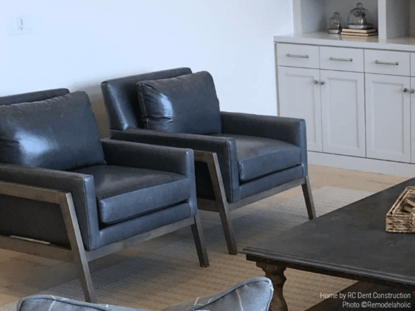 Mid Century Modern Leather Arm Chairs In A Mixed Style Living Room RC Dent Construction And Remedy Design 2018 Utah Valley Parade Of Homes Featured On Remodelaholic