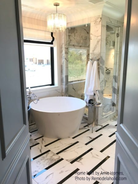 Round Bathtub With Bold Floor Tile Arive Homes (560)