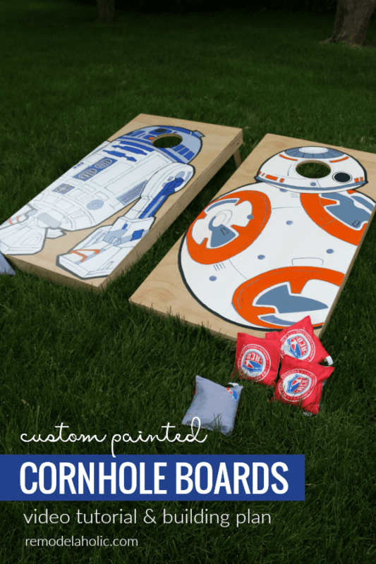 custom painted cornhole boards painted with Star Wars droids BB-8 and R2-D2, on the grass in a backyard