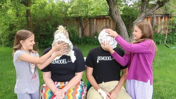 Pregnant Mom And Dad With Pie Smashed In Their Faces By Children For Baby Gender Reveal Party #remodelaholic