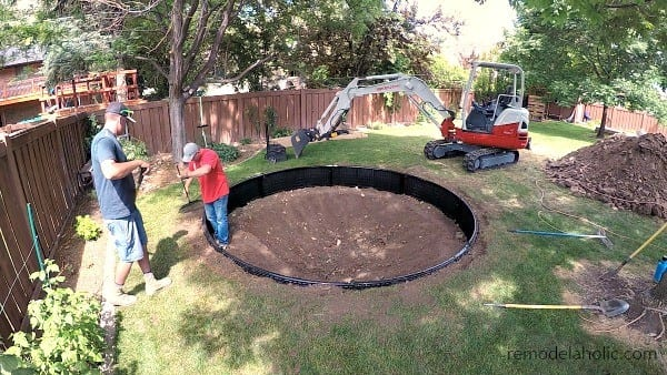 Cleaning Up The Edges Of The In Ground Trampoline Retaining Wall #remodelaholic