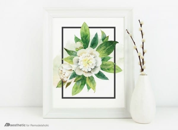 Free Printable Image Of A White Flower And Green Leaves In A Rectangular Box Sitting In A White Frame With A White Vase Next To It