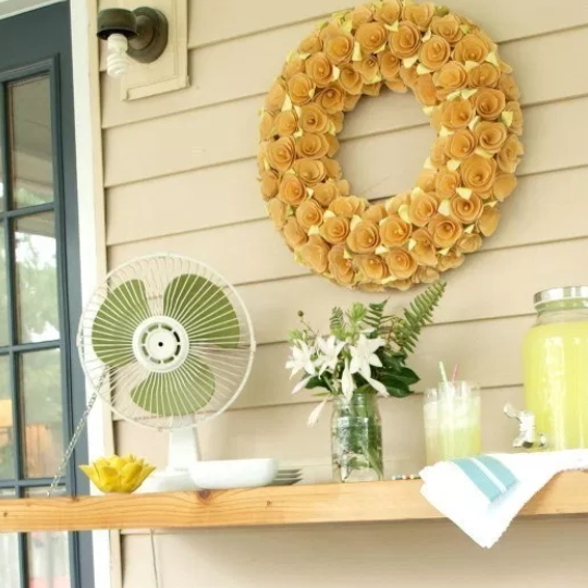 Gorgeous Wooden Drop Down Attached To Side Of House With Yellow Wreath Above