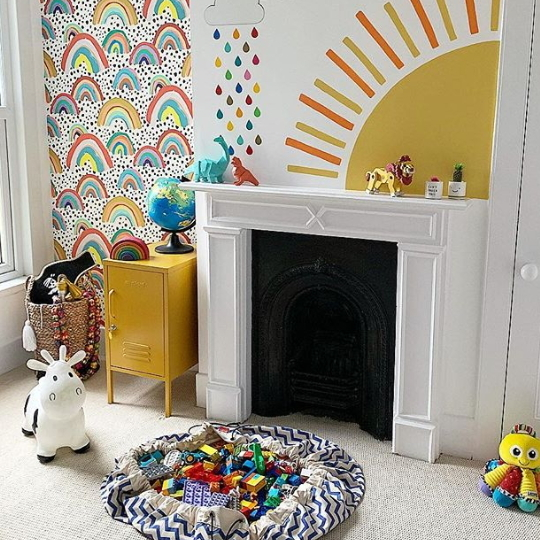 Playroom With Rainbow And Sunshine Wall Decor