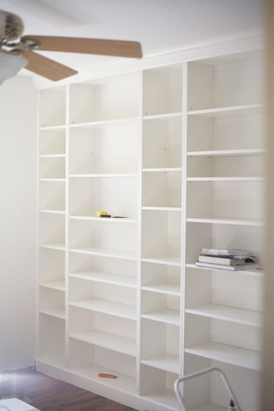 Pure White Built In Shelves Of Every Size, All Empty, Against White Walls
