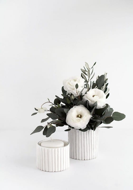 Textured White Vertical Line Vases, One With White Candle, Another With Greenery And Flowers