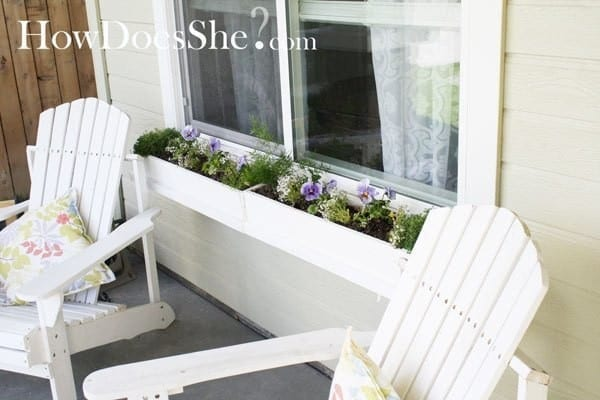 White Window Boxes With White Chairs And Pastel Floral Spring Pillows
