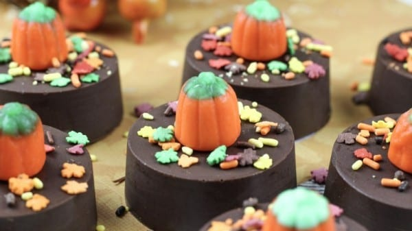 Chocolate Dipped Oreos With Fall Leaf Sprinkles And Candy Pumpkin On Top