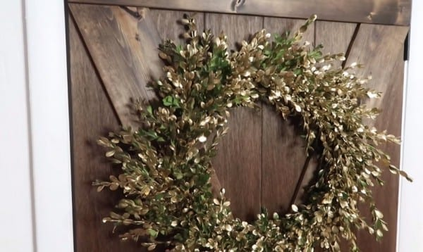 DIY Fresh Boxwood Wreath With Gold Accents On Brown Stained Barn Door