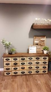 Medium Brown Colored Wooden Table With Light Brown Stained Rectangular Drawers Filling Entire Unit